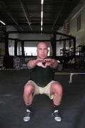 Air squat down frontal
