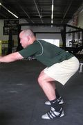 Air squat balls of feet